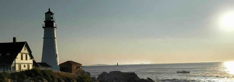 Banner image of a lighthouse for BlackRock Investigations & Consulting, serving the State of Maine.