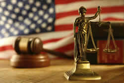 Image of thte American flag and scales of justice.